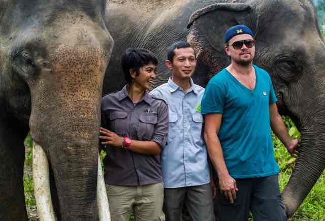 Wildlife Conservationists Farwiza Farhan with Leonardo DiCaprio for Wild Lives book
